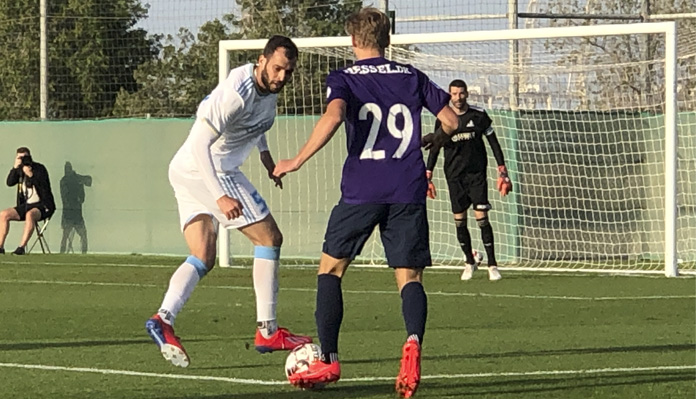 Gustav Isaksen taking on an Astana defender